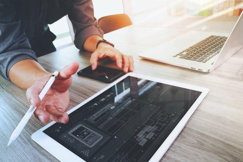 website-designer-working-digital-tablet-and-computer-laptop-and